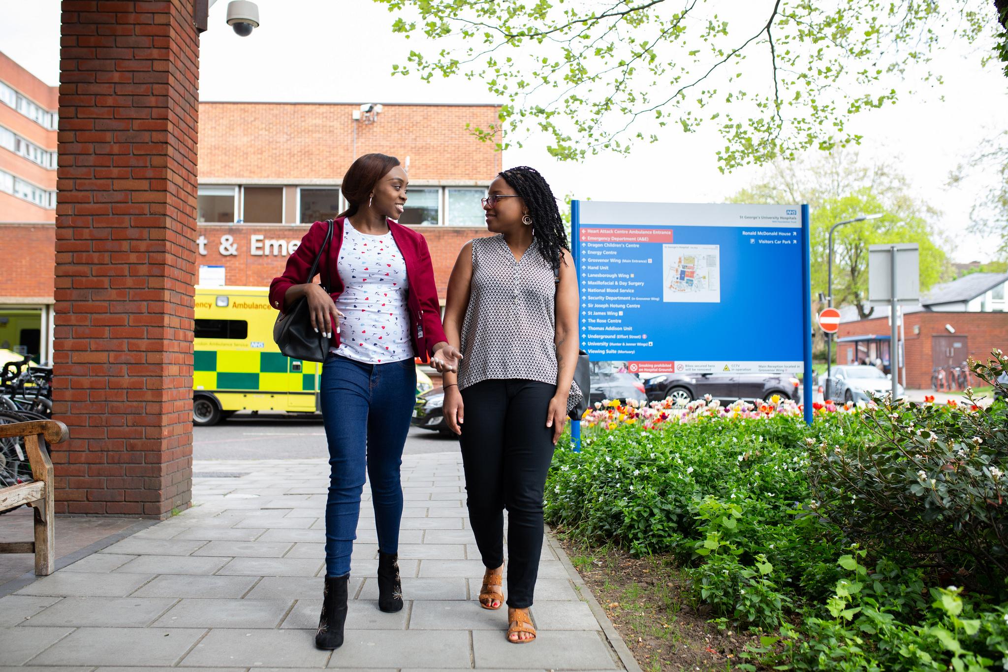Two women outside of a hospital