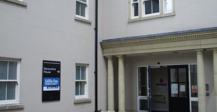 A building with an advertising board