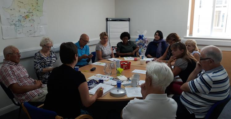 A group of volunteers sat around the table at a meeting