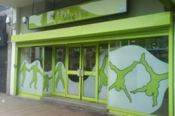 A green coloured shop front