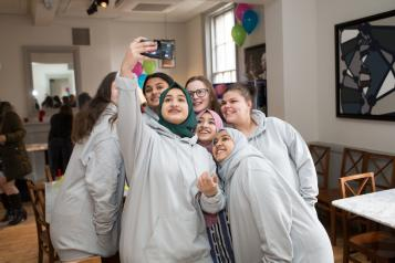 Group of young volunteers having a selfie