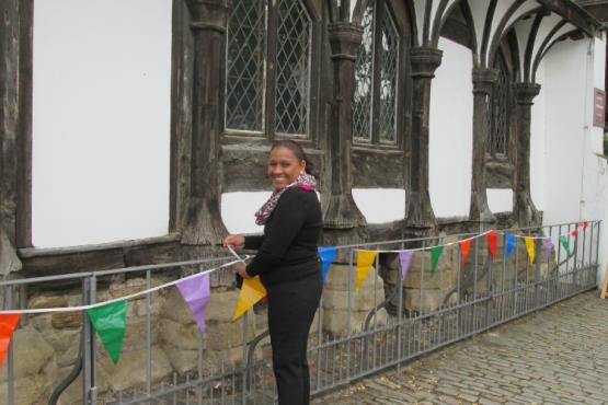 female volunteer putting on a ribbon