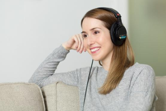Woman smiling with headphones on