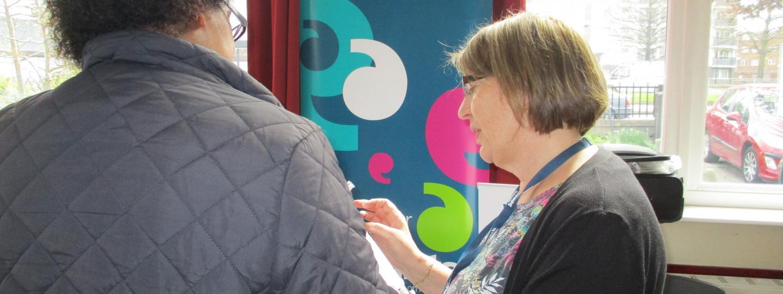 Young volunteers asking people their views